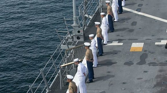 """Marines and Sailors """"man the rails"""" of the amphibious transport dock ship USS Somerset The marines are with the 11th Marine Expeditionary Unit and the sailors are with Amphibious Squadron Five. (U.S. Navy photo by MC1 Vladimir Ramos/Released)."""